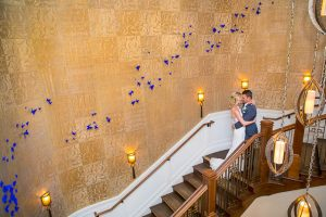 Bride and groom posing at the Butterfly Wall at their Belmond El Encanto wedding.