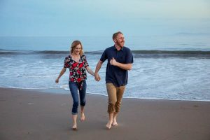 Couple having fun, being playful at their Santa Barbara engagement photoshoot.