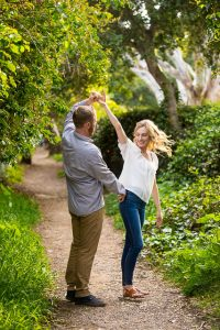 Lovers dancing together on the trail leading to the beach in Santa Barbara, California.