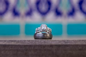 Wedding rings with Spanish tile background at the Santa Barbara Courthouse.