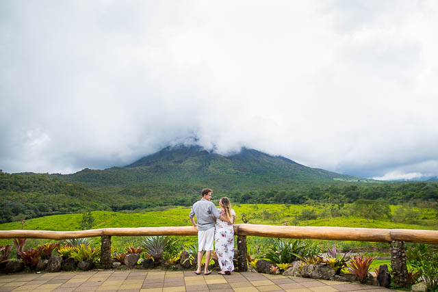 Engaged couple overlooking Arenal Volcano in La Fortuna, Costa Rica, during their La Fortuna engagment photoshoot.