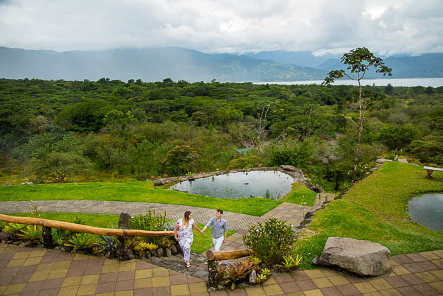 Engaged couple walking together at Arenal Volcano in La Fortuna, Costa Rica.
