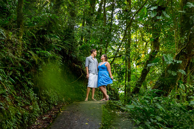 Engaged couple posing at the Selvatura Park at the raincloud forest in Monteverde, Costa Rica.