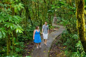 Engaged couple posing at the Selvatura Park at the cloud forest in Monteverde, Costa Rica.