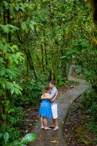 Engaged couple posing at the Selvatura Park at the raincloud forest in Monteverde, Costa Rica during their engagement photoshoot.