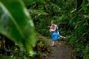 Engaged couple wandering in the Costa Rican cloud forest during their engagement photoshoot.