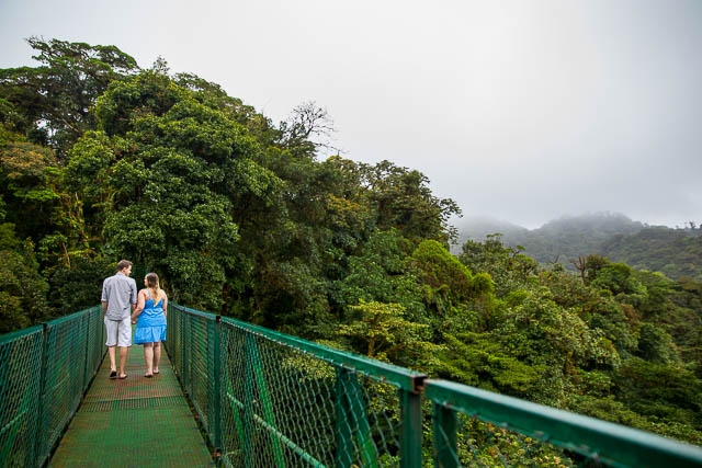 Couple walking across the hanging bridges in the raincloud forest of Selvatura Park in Monteverde, Costa Rica.