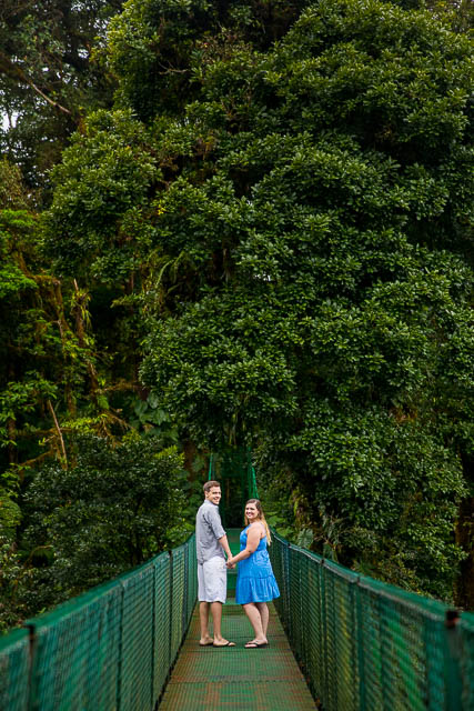 Couple walking across the hanging bridges in the rain cloud forest of Selvatura Park in Monteverde, Costa Rica.