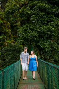 Couple posing on a hanging bride at the Selvatura Park in Monteverde, Costa Rica.